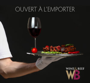 Hand of waiter with champagne on dark background