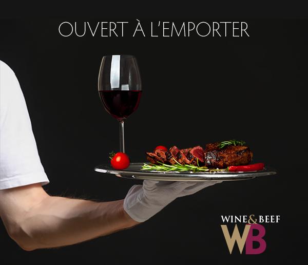 Hand of waiter with champagne on dark background
